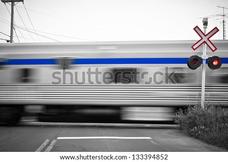 Passing trains at level crossing - stock photo