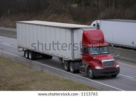 Passing Trucks on the Highway - stock photo