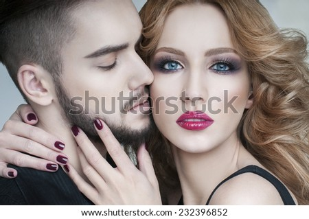 Passion couple. Couple portrait. Beautiful couple in love. Blond woman hugging a man.  Portrait of  beauty blond girl and her handsome boyfriend. Love. Lovers. Valentines Day - stock photo