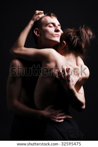 Passion couple in dark - stock photo