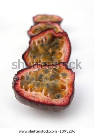 Passion fruit cut in half on a white back ground