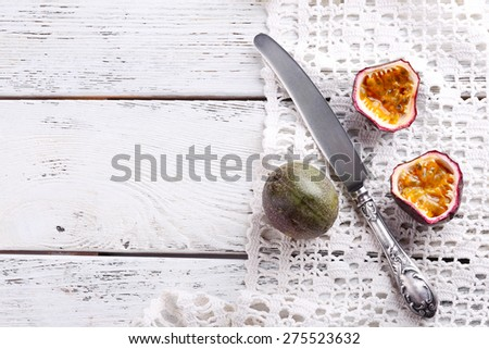 Passion fruits on color wooden background - stock photo