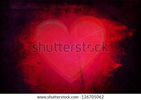 Passion heart frame / background. Vibrant red, pink, purple tones on a rough aged scratchy background with dark burnt edges. - stock photo