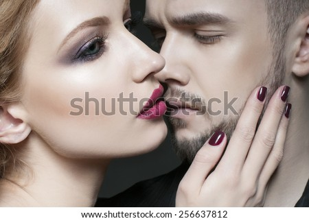 Passionate couple. Beautiful young man and blond woman closeup. Woman hugging a man.Woman hugging man. Love. Flirt. Kiss. Lovers.  Portrait of beauty blond girl and her handsome boyfriend.  - stock photo