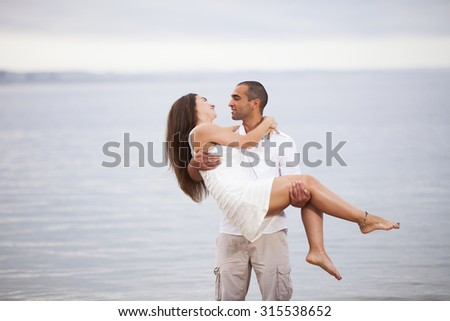Passionate couple having fun at the beach - stock photo
