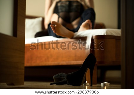 Passionate couple having sex in hotel room - stock photo