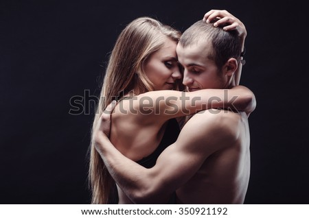 Passionate couple in love. Woman tenderly embraces man.