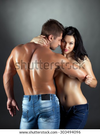 Passionate couple posing with shiny sweaty bodies