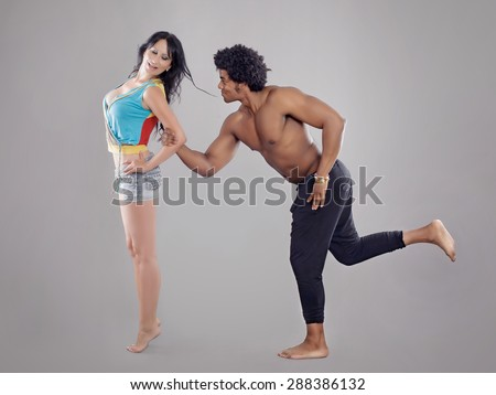 Passionate couple. Young and sexy passionate couple on gray studio background