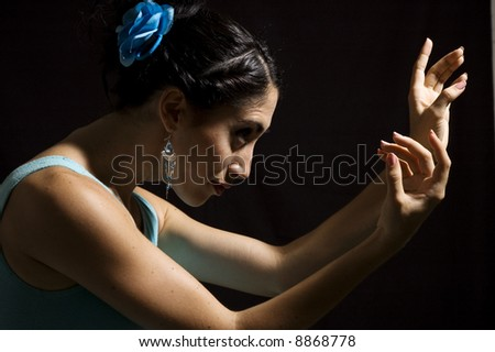 Passionate flamenco dancer girl isolated on black - stock photo