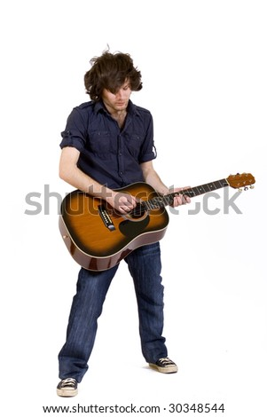 passionate guitarist playing an acoustic guitar