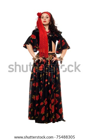 Passionate gypsy woman in a black skirt. Isolated - stock photo