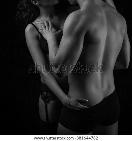 Passionate heterosexual couple in a moment of intimacy - stock photo