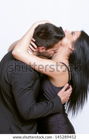 Passionate kiss between a couple - stock photo