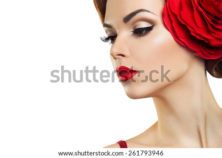Passionate lady with a red flower in her hair