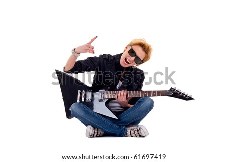 passionate rock girl playing an electric guitar seated and making a rock gesture - stock photo