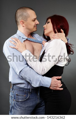 Passionate romance between office colleagues, studio shot
