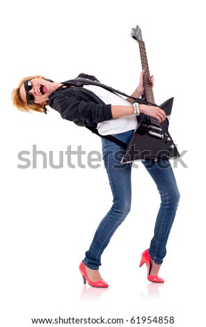 passionate young blond girl playing her electric guitar - stock photo