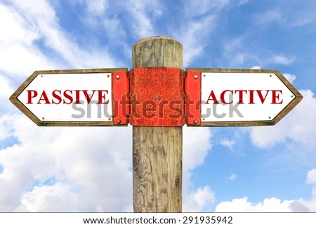 Passive versus Active messages - Wooden signpost with two opposite arrows on the blue sly background. Choice chance and change of lifestyle conceptual image - stock photo