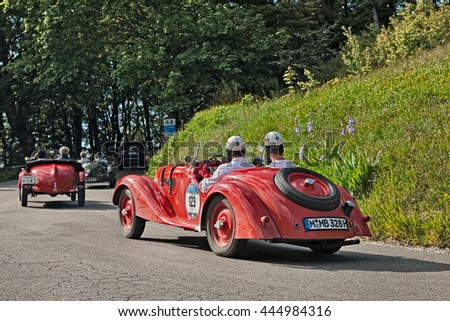 PASSO DELLA FUTA (FI), ITALY - MAY 21: driver and co-driver on a classic German car BMW  328 (1937) in historical race Mille Miglia, on May 21, 2016 in Passo della Futa (FI) Italy