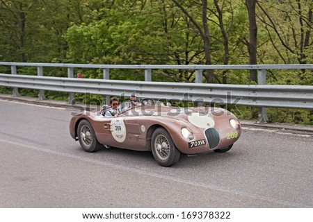 PASSO DELLA FUTA (FI), ITALY - MAY 18: unidentified crew on am old racing car Jaguar C-Type (1952) in italian historical rally Mille Miglia 2013, on May 18, 2013 in Passo della Futa (FI) Italy