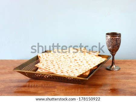 passover background. wine and matzoh over wooden table.