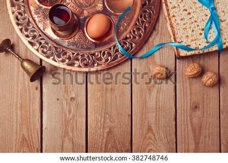 Passover background with matzo, wine and old seder plate. View from above - stock photo