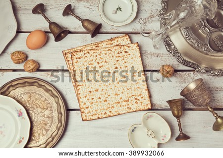 Passover background with matzoh on wooden table. View from above. Flat lay - stock photo