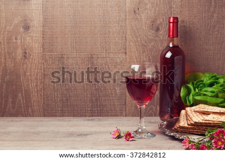 Passover celebration with wine and matzoh over wooden background - stock photo