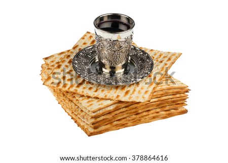 passover matzo with kiddush cup of wine isolated on white background - stock photo