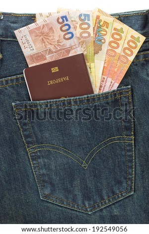 Passport and Hong Kong Dollar in denim jeans pocket