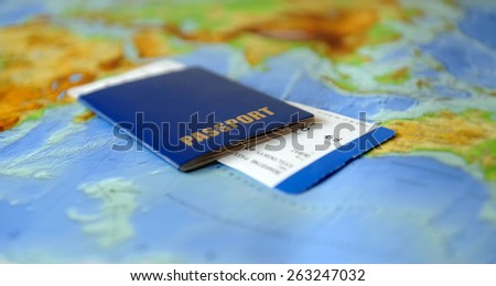Passport and ticket  on a background map of the world. Traveling concept - stock photo