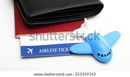 Passport flight ticket with small airplane. - stock photo