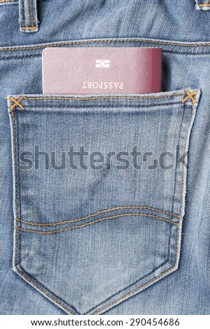 passport in jean pants - stock photo