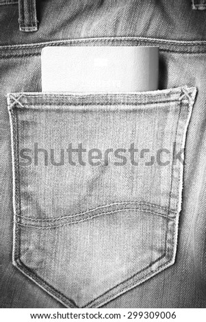 passport in jean pants black and white tone color style - stock photo