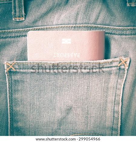passport in jean pants retro vintage style - stock photo
