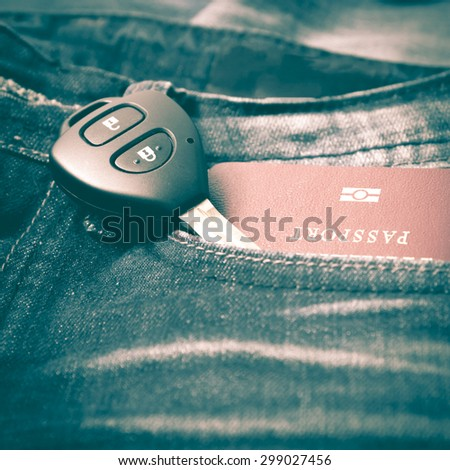 passport in jean pocket with car key retro vintage style - stock photo