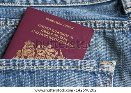 Passport in jeans pocket - stock photo