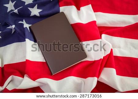 Passport on an American flag - stock photo