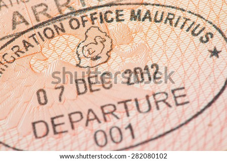 Passport page with Mauritius immigration control departure stamp with traditional Dodo bird depicted on it.  - stock photo