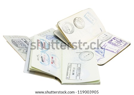 Passport Stamps/ three passports opened at stamped pages