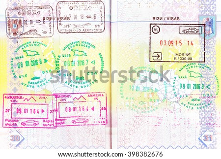 Passport with stamps of Azerbaijan, Georgia, Armenia and Albania - stock photo