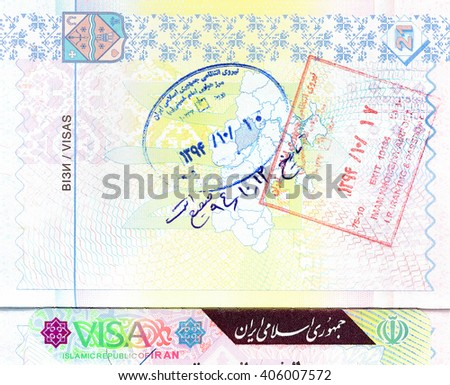 Passport with visa and entry and exit stamps of Iran - stock photo