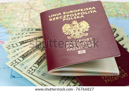 Passports and money over map background - stock photo