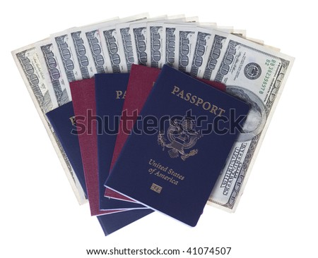 Passports and stack of US one hundred dollars bills