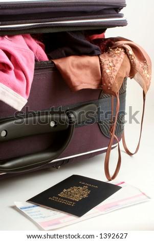 passports and suitcase - stock photo