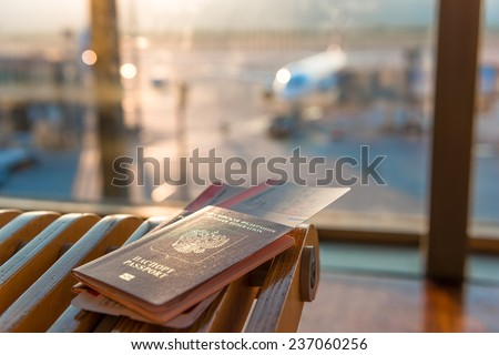 passports and tickets on a background of an airplane - stock photo