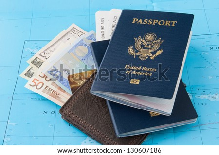 Passports and wallet with dollars, euro and credit card on a map background. Travel concept. - stock photo