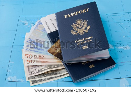 Passports,  cash and plastic card on a map background. Travel concept. - stock photo