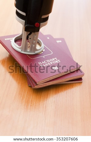 Passports on a table lie waiting for border control and a trip - stock photo